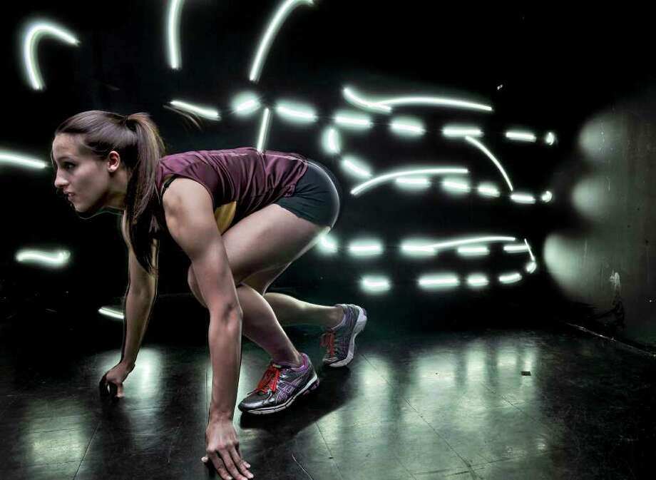 Colonie track standout Kyle Plante poses for portrait in the Times Union photography studio on Monday evening March 19, 2012 in Colonie, N.Y.  The lighting effect behind her is the result of a double exposure within the camera, with a flashlight shone towards the camera. (Philip Kamrass / Times Union ) Photo: Philip Kamrass / 00016844A