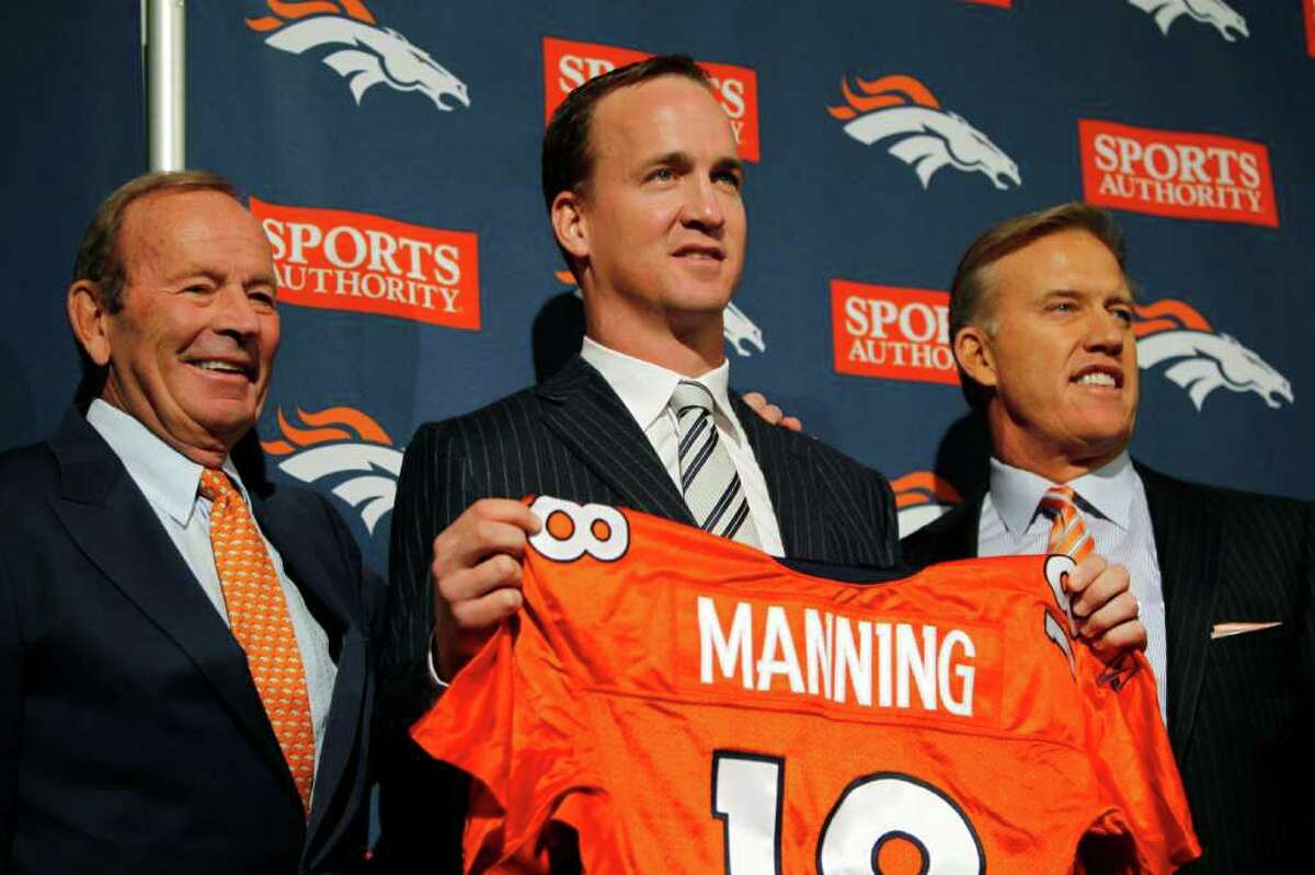 From left, Denver Broncos owner Pat Bowlen, newly-signed quarterback Peyton Manning and executive vice president of football operations John Elway pose for photos during an NFL football news conference at the team's headquarters in Englewood, Colo., on Tuesday, March 20, 2012. (AP Photo/David Zalubowski)