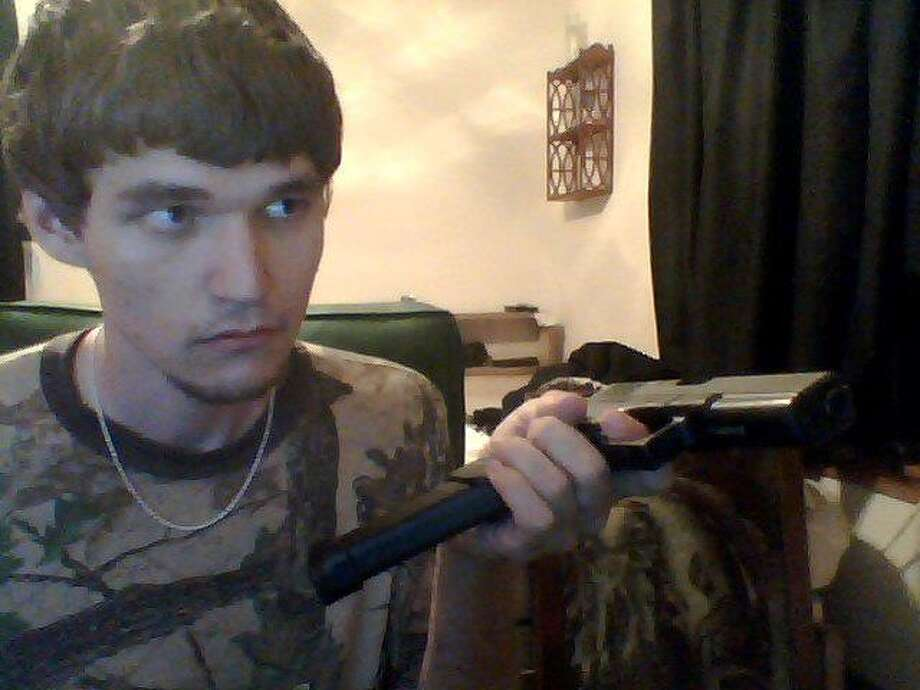 Images posted to Trey Sesler's Facebook page show him holding what appears to be a gun.