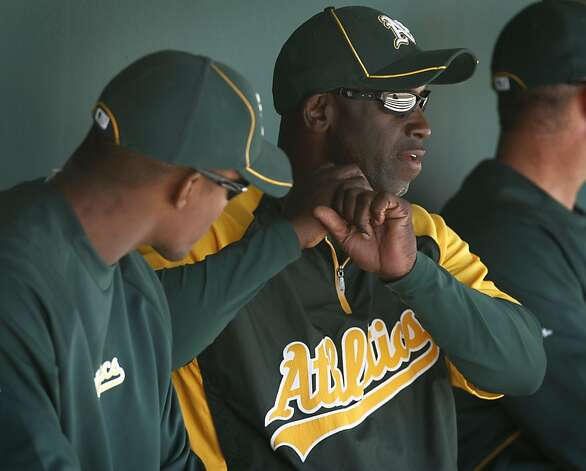 Batting coach Chili Davis (right) works with Cedric Hunter before the Oakland A's Cactus League spring training game against the Los Angeles Dodgers in Glendale, Ariz. on Thursday, March 8, 2012. Photo: Paul Chinn, The Chronicle