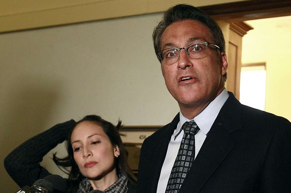 FILE - In this Jan. 13, 2012 file photo, San Francisco Sheriff Ross Mirkarimi, right, and his wife Eliana Lopez speak to reporters at City Hall in San Francisco. Mirkarimi has pleaded guilty to false imprisonment in a domestic violence case. Mirkarimi entered the plea Monday in a San Francisco courtroom. He was fined $590 and sentenced to three years of probation and a year of counseling. He will also be required to take parenting classes. (AP Photo/Jeff Chiu, file)