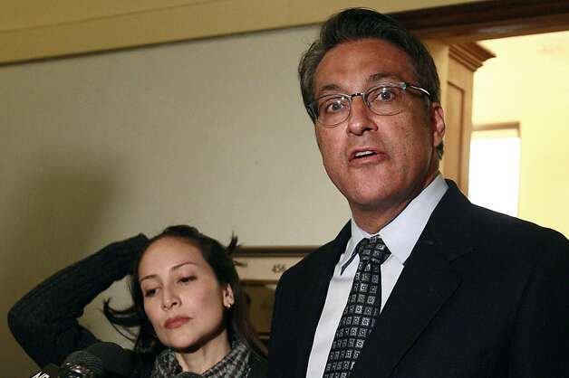 FILE - In this Jan. 13, 2012 file photo, San Francisco Sheriff Ross Mirkarimi, right, and his wife Eliana Lopez speak to reporters at City Hall in San Francisco. Mirkarimi has pleaded guilty to false imprisonment in a domestic violence case.  Mirkarimi entered the plea Monday in a San Francisco courtroom. He was fined $590 and sentenced to three years of probation and a year of counseling. He will also be required to take parenting classes. (AP Photo/Jeff Chiu, file) Photo: Jeff Chiu, Associated Press