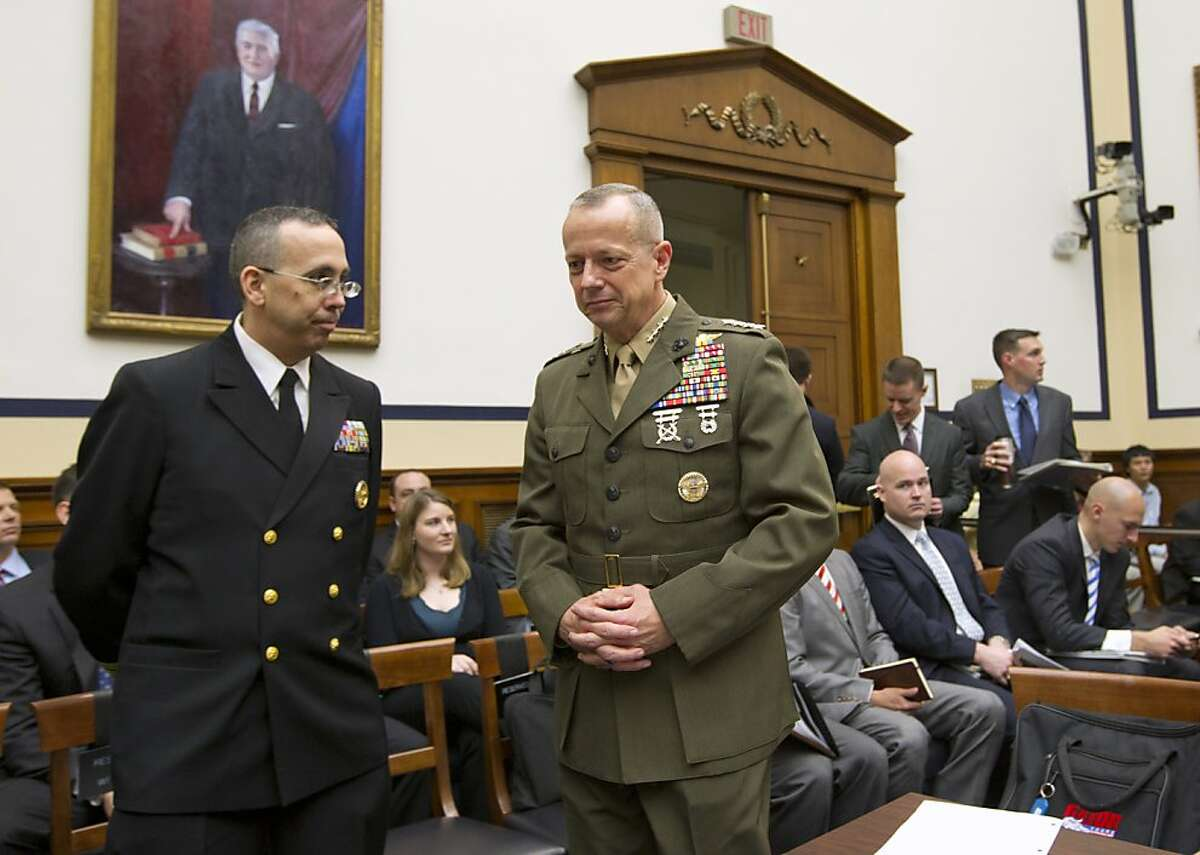 Marine Gen. John Allen, the top U.S. commander in Afghanistan, right, arrives on Capitol Hill in Washington, Tuesday, March 20, 2012, to testify before the House Armed Services Committee hearing on Afghanistan.