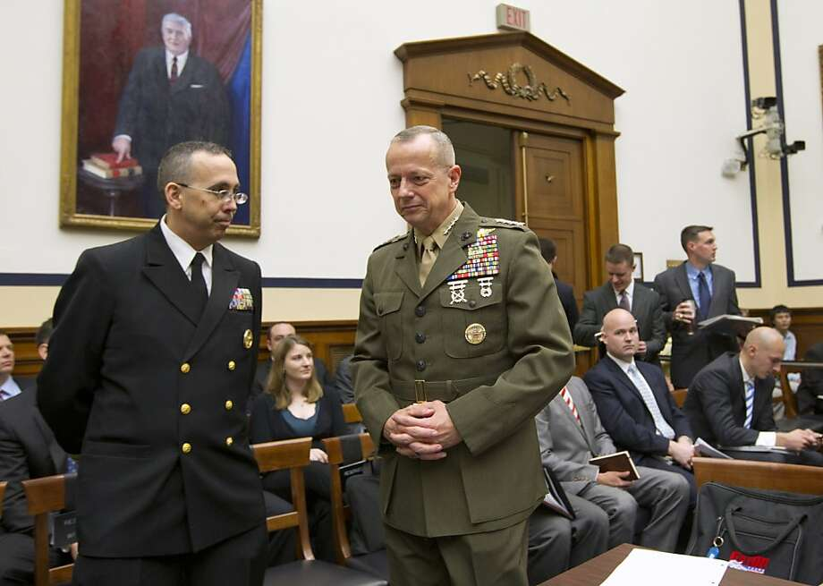Marine Gen. John Allen, the top U.S. commander in Afghanistan, right, arrives on Capitol Hill in Washington, Tuesday, March 20, 2012, to testify before the House Armed Services Committee hearing on Afghanistan. Photo: J. Scott Applewhite, Associated Press