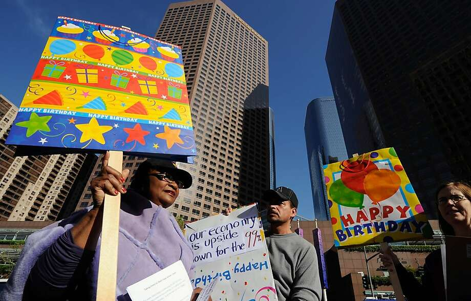 LOS ANGELES, CA - MARCH 20:  Doris Wallace (L) Mauricio Toscano (C) Gail Gabler hold birthday signs during a protest march at the Wells Fargo bank headquarters in downtown Los Angeles on March 20, 2012 in Los Angeles, California. Several hundred protesters marked the bank's 160th year with a satirical birthday and protesting the bank's foreclosure practices.  (Photo by Kevork Djansezian/Getty Images) Photo: Kevork Djansezian, Getty Images