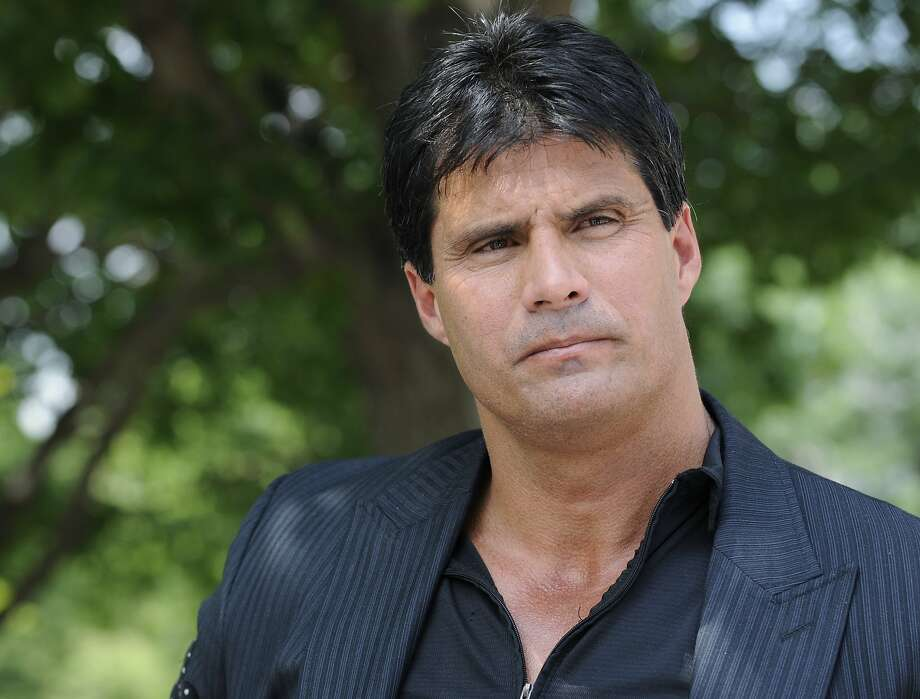 FILE - This June 3, 2010, file photo shows Jose Canseco talking with reporters in Washington. A celebrity boxing promoter has won a default judgment against Jose Canseco for breach of contract after the former major-league slugger instead sent his twin brother for the bout. Damon Feldman, of Broomall, Pa., won his complaint Wednesday, July 20, 2011,  after Canseco failed to show for his district court appearance. Photo: Susan Walsh, AP