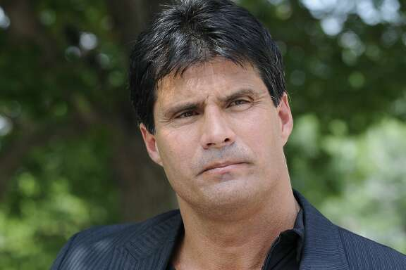 FILE - This June 3, 2010, file photo shows Jose Canseco talking with reporters in Washington. A celebrity boxing promoter has won a default judgment against Jose Canseco for breach of contract after the former major-league slugger instead sent his twin brother for the bout. Damon Feldman, of Broomall, Pa., won his complaint Wednesday, July 20, 2011,  after Canseco failed to show for his district court appearance.
