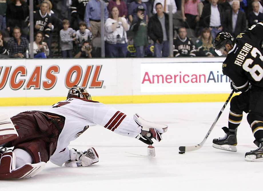 Phoenix Coyotes goalie Mike Smith (41) dives but is unable to stop Dallas Stars' Mike Ribeiro from scoring in a shootout during an NHL hockey game Tuesday, March 20, 2012, in Dallas. The Stars won 4-3. (AP Photo/Tony Gutierrez) Photo: Tony Gutierrez, Associated Press