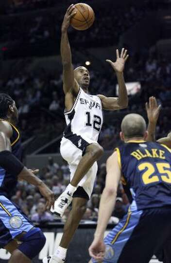 SPORTS    Bruce Bowen gets a layup in the second half against Denver Wednesday night at the AT&T Cen