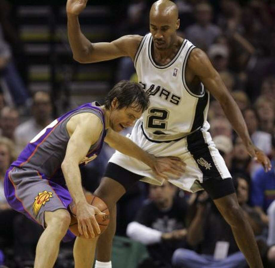 SPORTS - Spurs' Bruce Bowen defends Suns' Steve Nash in the first half of game four of their second round series Monday, May 14, 2007 at the AT&T Center.  BAHRAM MARK SOBHANI/STAFF (SAN ANTONIO EXPRESS NEWS)