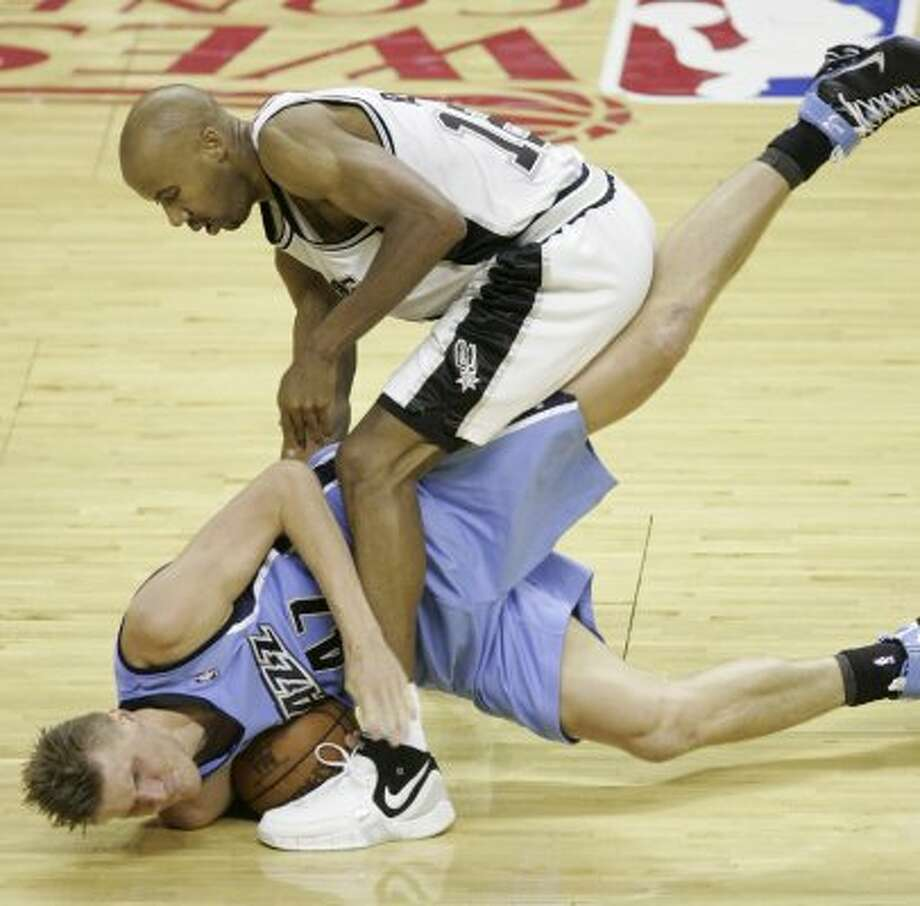 Spurs' forward Bruce Bowen (12) and  Jazz forward Andrei Kirilenko, of Russia, (47) battling for the ball during first half action in the Western Conference Finals game five in San Antonio Wednesday May 30, 2007.  (BAHRAM MARK SOBHANI/STAFF) (SAN ANTONIO EXPRESS-NEWS)