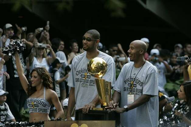 METRO - Tim Duncan, left, and Bruce Bowen, right, pass cheering fans on the parade route during the Spurs NBA Championship river parade on Sunday, June 17, 2007. Lisa Krantz/STAFF (SAN ANTONIO EXPRESS-NEWS)