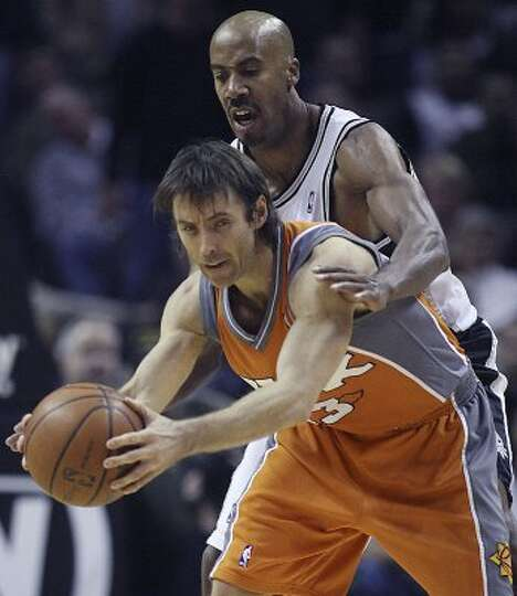 SPTS- Spurs Bruce Bowen pressures Phoenix Suns Steve Nash in the 3rd period of play at the at&t cent