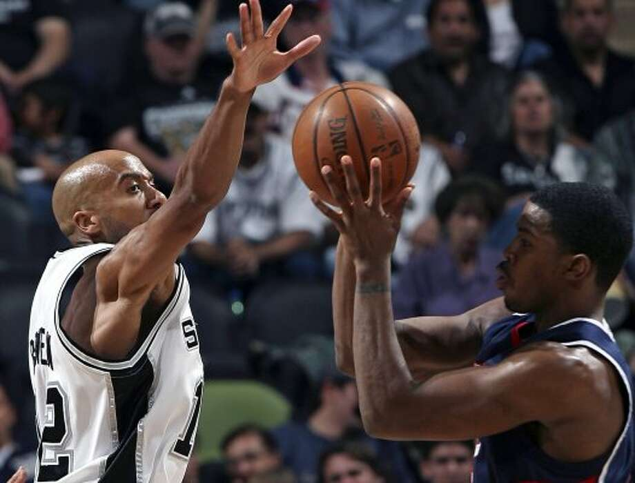 SPORTS   Bruce Bowen moves to block the ball against Atlanta's Joe Johnson in the first half Monday at the AT&T Center. San antonio Spurs versus the Atlanta Hawks at the AT&T Center.    Tom Reel/Staff   February  25, 2008. (SAN ANTONIO EXPRESS-NEWS)