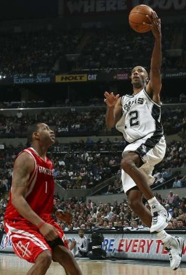 FOR SPORTS - Spurs' Bruce Bowen shoots over Rockets' Tracy McGrady during second half action Sunday March 30, 2008 at the AT&T Center.  The Spurs won 109-88. (PHOTO BY EDWARD A. ORNELAS/STAFF) (SAN ANTONIO EXPRESS-NEWS)