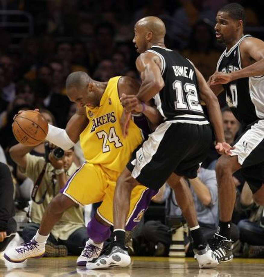 Under the pressure of a double team of San Antonio Spurs Bruce Bowen and Kurt Thomas, Los Angeles Lakers Kobe Bryant is able to escape the trap during the second half of game 5 of the NBA Western Conference Finals at Staple Center in Los Angeles on Thursday, May 29, 2008. The Lakers beat the Spurs 100-92 and won the Western Conference Championship.   JERRY LARA/glara@express-news.net (San Antonio Express-News)