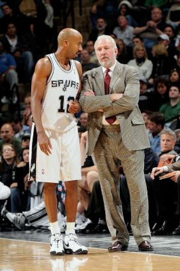 SAN ANTONIO - DECEMBER 10:  (L-R) Bruce Bowen #12 of the San Antonio Spurs talks to Head Coach Gregg Popovich during the game against the Atlanta Hawks at the AT&T Center on December 10, 2008 in San Antonio, Texas.  The Spurs won 95-89.  NOTE TO USER: User expressly acknowledges and agrees that, by downloading and/or using this Photograph, user is consenting to the terms and conditions of the Getty Images License Agreement. Mandatory Copyright Notice: Copyright 2008 NBAE  (Photo by D. Clarke Evans/NBAE via Getty Images) (NBAE/Getty Images)