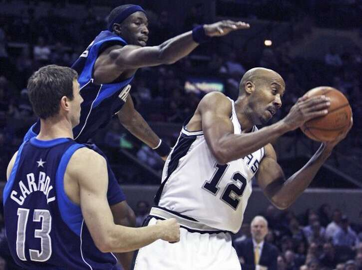 SPORTS    Bruce Bowen grabs a rebound as the Spurs play the Dallas Mavericks at the AT&T Center Febr