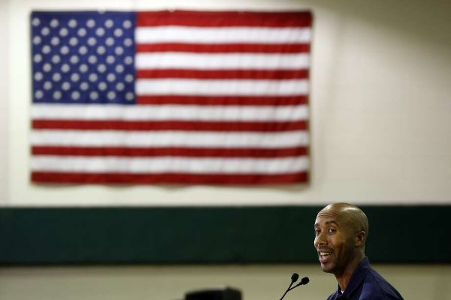 METRO -- Former San Antonio Spurs player, Bruce Bowen addresses a group of over sixty volunteers from BBVA Compass before starting the revitalization of John F. Kennedy High School in the Edgewood Independent School District, Tuesday, May 3, 2011. The NBA Cares group, including Bowen, George Gervin and WNBA Minnesota Lynx forward-center Taj McWilliams-Franklin, teamed up with the volunteers for the revitalization. JERRY LARA/glara@express-news.net (SAN ANTONIO EXPRESS-NEWS)