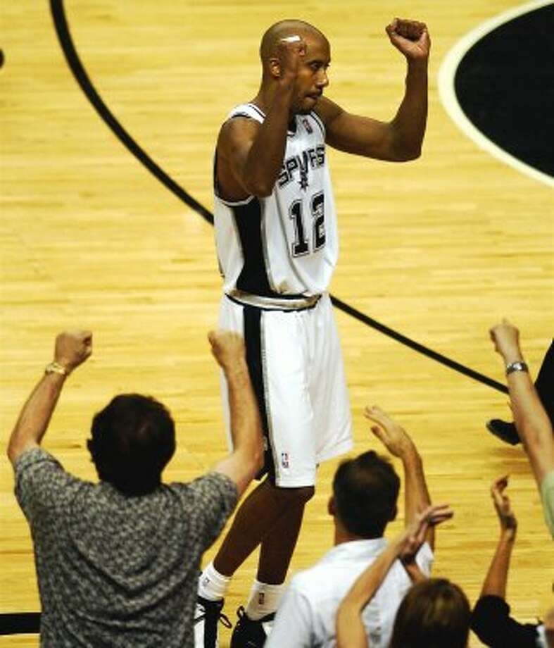 Spurs Bruce Bowen celebrates the Spurs narrow vistory over the Lakers as fans react also during Game 5 of the  Western Conference Semifinals at the SBC Center in San Antonio, TX Tuesday May 13, 2003.  PHOTO BY TOM REEL/STAFF (SAN ANTONIO EXPRESS-NEWS)