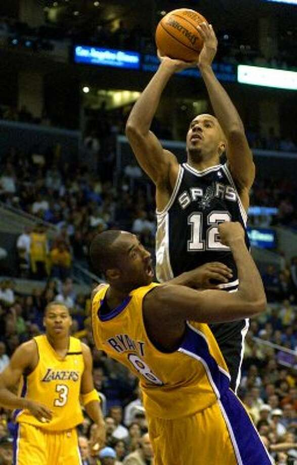 SPORTS   ---   The Spurs' Bruce Bowen shoots Thursday night May 15, 2003 at the Staples Center in Los Angeles over a surprised Kobe Bryant during the 6th game of the best-of-seven Western Conference Semi-finals. The Spurs won 110-82 to advance to the conference finals.   (WILLIAM LUTHER/STAFF) (SAN ANTONIO EXPRESS-NEWS)