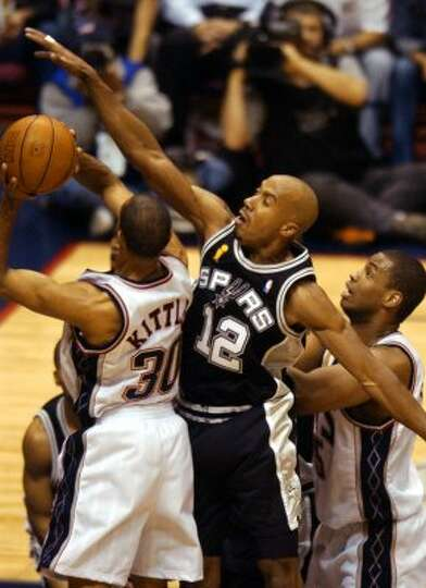 Bruce Bowen defends Nets Kerry Kittles during first quarter action of game three NBA Finals at the C