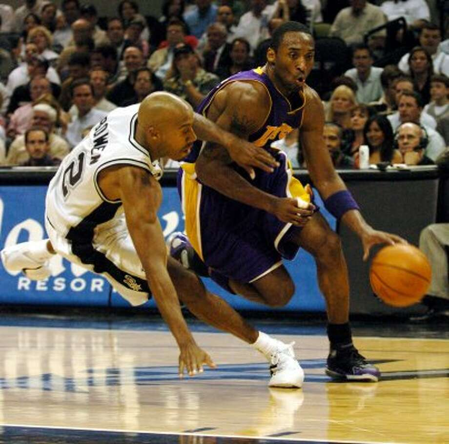 Lakers' Kobe Bryant (right) drives past Spurs' Bruce Bowen during second quarter of Game 5 of the Spurs against the Los Angeles Lakers in the Western Conference semifinals at the SBC Center in San Antonio on Thursday, May 13, 2004.  (Kin Man Hui/staff) (SAN ANTONIO EXPRESS-NEWS)