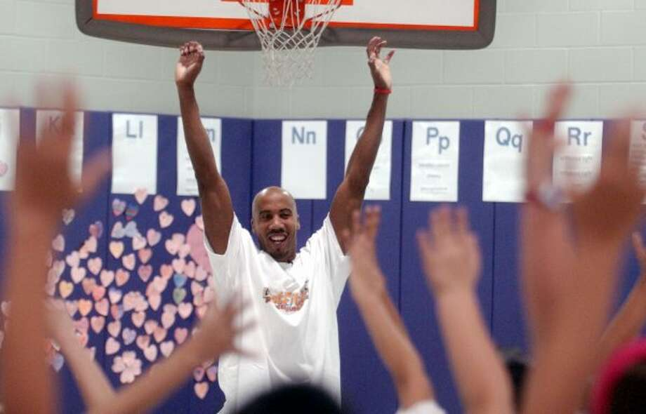 SPORTS -- Bruce Bowen shoes fourth graders at Woodlawn Hills Elementary how to stretch following exercise.  As part of his work toward a degree at UTSA, Bowen has started a GET FIT program for youths.  Monday February 7, 2005.  (Robert McLeroy/Staff) (SAN ANTONIO EXPRESS-NEWS)