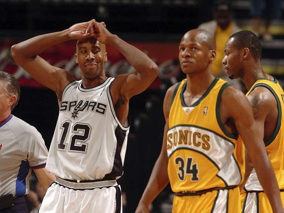 SPORTS -The Spurs' Bruce Bowen looks over at the Sonics' Ray Allen after Bowen was called for fouling Allen in game two of their Western Conference Semifinals Tuesday, May 10, 2005 a the SBC Center. BAHRAM MARK SOBHANI/STAFF (SAN ANTONIO EXPRESS NEWS)