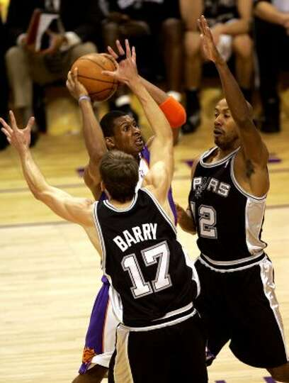 Spurs Brent Barry and Bruce Bowen defend Suns Leanardo Barbosa during second quarter action of the f
