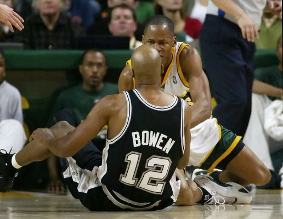 Seattle SuperSonics' Ray Allen, back, reacts to San Antonio Spurs' Bruce Bowen during the second quarter of an NBA basketball game in Seattle, Sunday, March 26, 2006. Allen was first called for an offensive foul and Bowen responded by apparently kicking Allen. Bowen was given a technical, and Allen had to be restrained. (AP Photo/John Froschauer) (AP)