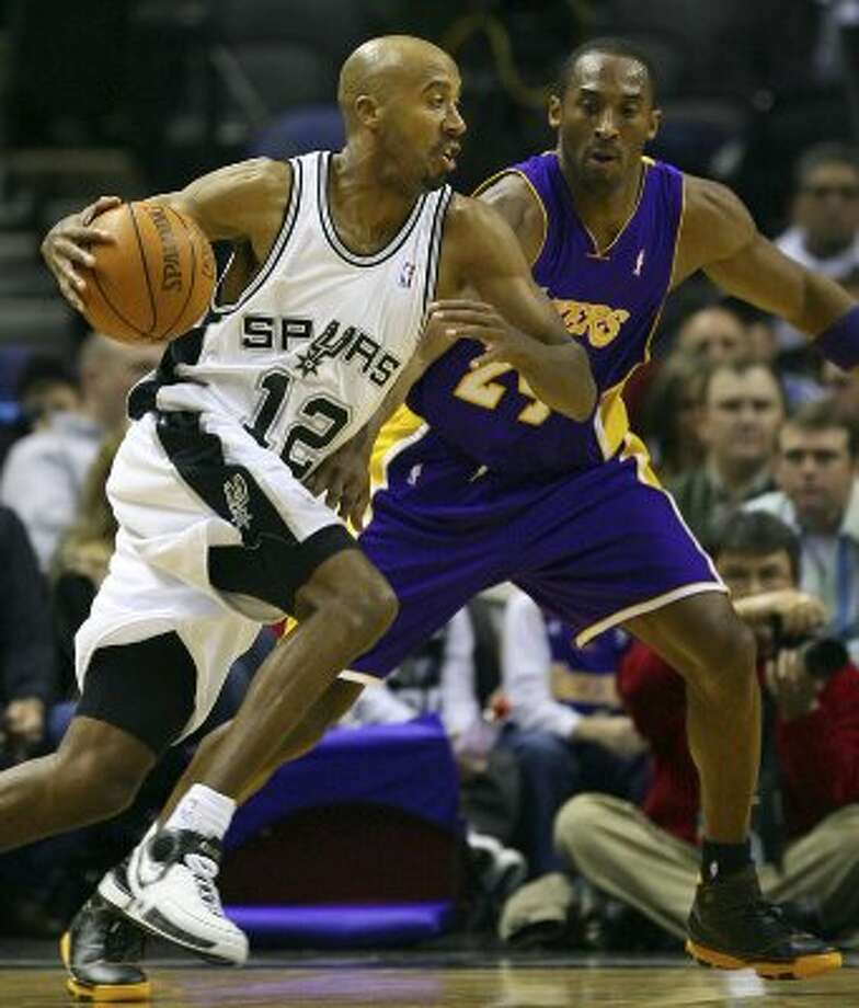 FOR SPORTS - Spurs' Bruce Bowen drives around Lakers' Kobe Bryant during first half action Wednesday Jan. 17, 2007 at the AT&T Center. PHOTO BY EDWARD A. ORNELAS/STAFF (SAN ANTONIO EXPRESS-NEWS)