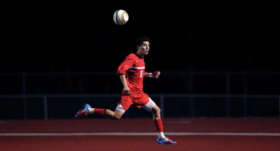 Judson's Andrew Gomez runs the ball down in the deep corner as Steele hosts the Rockets on Tuesday, March 20, 2012. Photo: TOM REEL, San Antonio Express-News / San Antonio Express-News