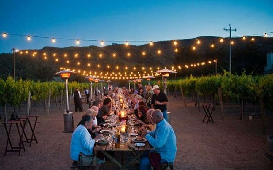 Since 2009, Chateau Julien Wine Estate's Dine in Di-Vine has been a highlight of the Monterey Peninsula's Classic Car Week. The family-style dinner is served in the 5-acre Sangiovese vineyard. Photo: Chateau Julien Wine Estate