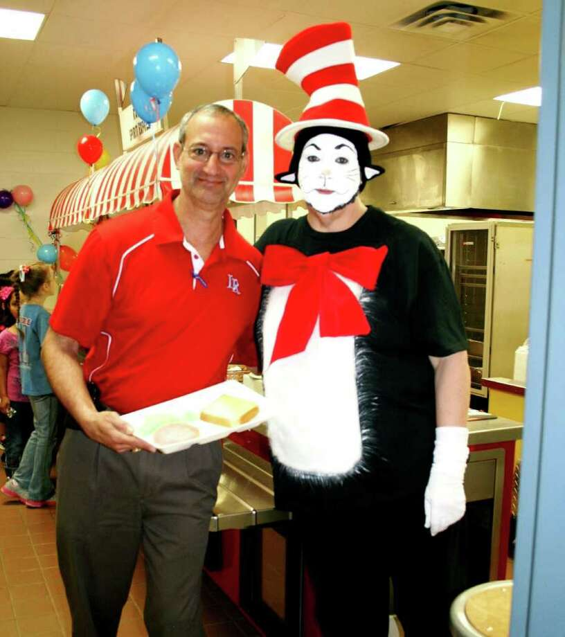 Lumberton ISD Superintendent John Valastro, left, and Primary School Nutrition Manager Melody Sorokolit, right, join the Early Childhood and Primary School students celebrate Dr. Seuss's birthday with green eggs and ham for breakfast on March 1. Photo: Kathryne Colligan, Lumberton ISD, HCN_Green
