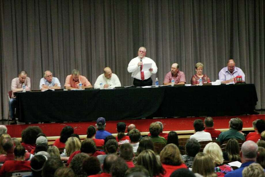 Kountze ISD Superintendent Kevin Weldon (center) addresses the audience at the regular meeting of the KISD Board of Trustees Monday evening. An estimated 400 citizens were in attendance as Trustees addressed personnel issues. Photo: David Lisenby, HCN_KISD
