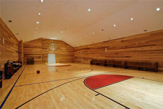 This handsome barn like court is part of a 10 800 woodway for Building indoor basketball court