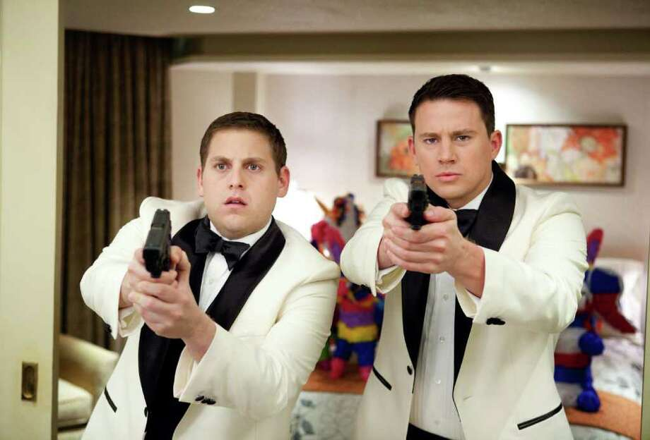 "Jonah Hill, left, and Channing Tatum star in Columbia Pictures' action comedy ""21 Jump Street."" (Courtesy of Scott Garfield/Columbia Pictures/MCT) Photo: Handout / Columbia Pictures"