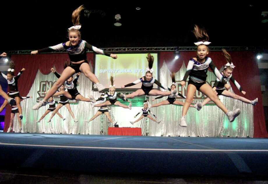 "The Greenwich-based Spirit Zone's Junior Level One Cheerleading Team, ""Amazonites"", received two awards at the Mardi Gras Nationals, which were held recently at the Mass. Mutual Center in Springfield. Above, leading the charge during one of the team's routines are, from left, Lyndsey McNaney and Julia Tramposch. Photo: Contributed Photo"