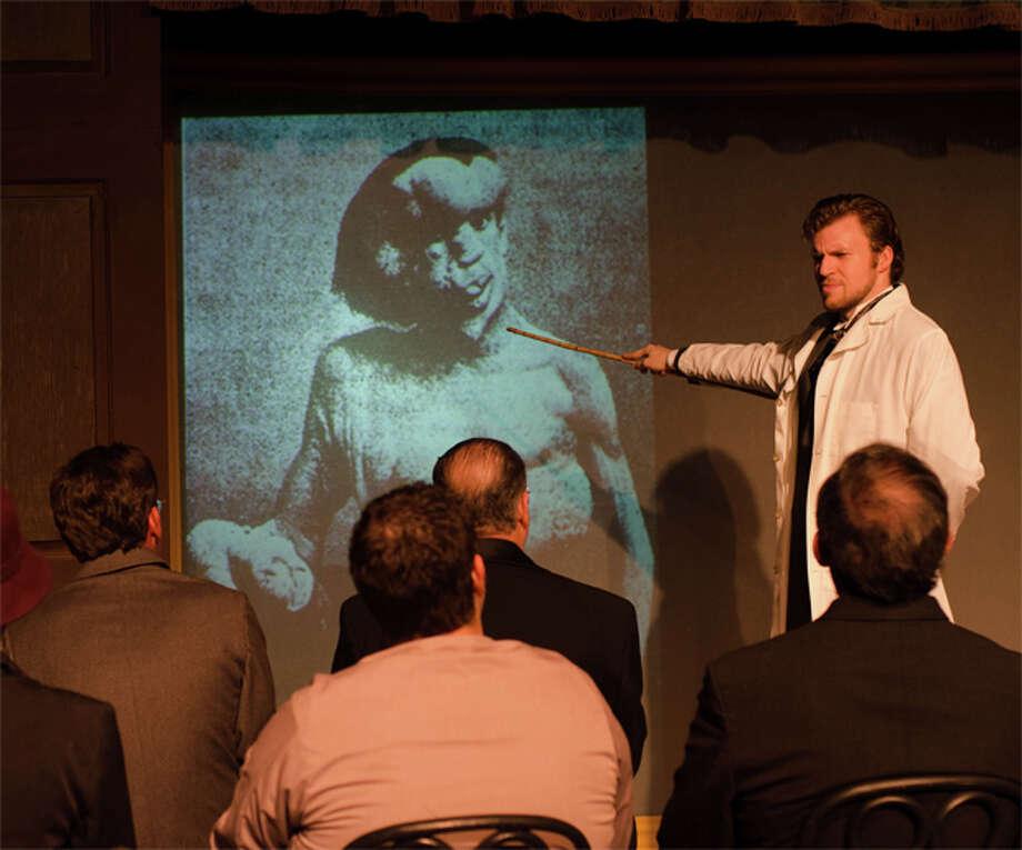 As Dr. Treves, Michael Burger displays photos of Englishman Joseph Merrick, effectively portrayed as John Merrick by Rex Harder. Photo: Courtesy, James Teninty