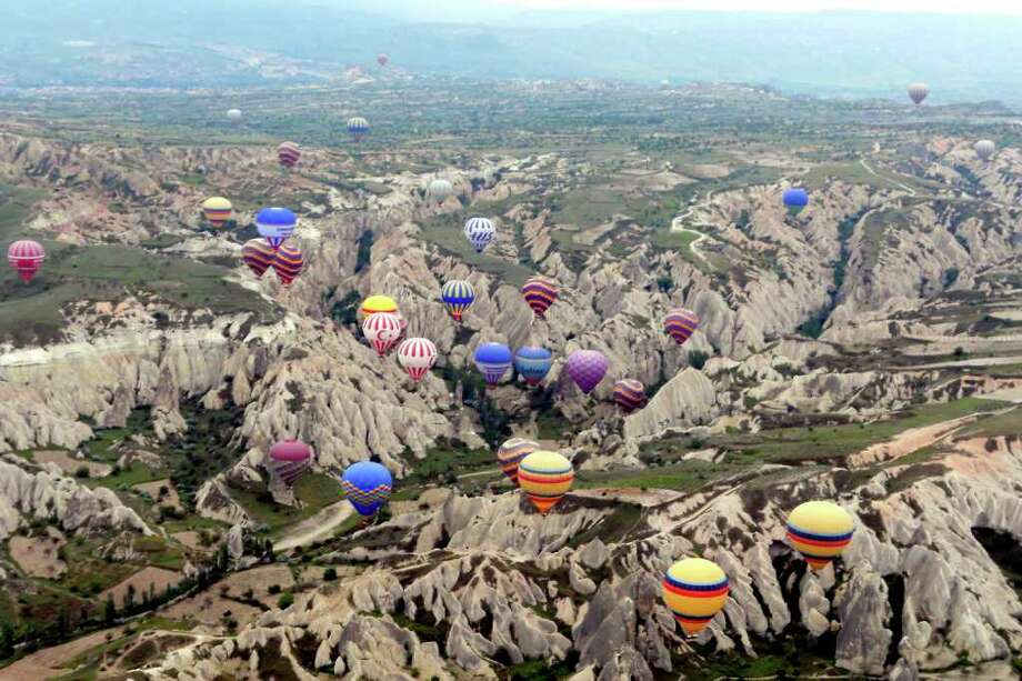 A majestic balloon ride in central Turkey can take you over the eroded Photo: Ricksteves.com