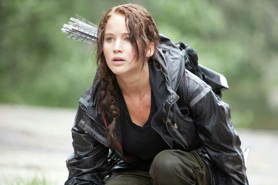 "In this image released by Lionsgate, Jennifer Lawrence portrays Katniss Everdeen in a scene from ""The Hunger Games."" (AP Photo/Lionsgate, Murray Close) Photo: Murray Close"