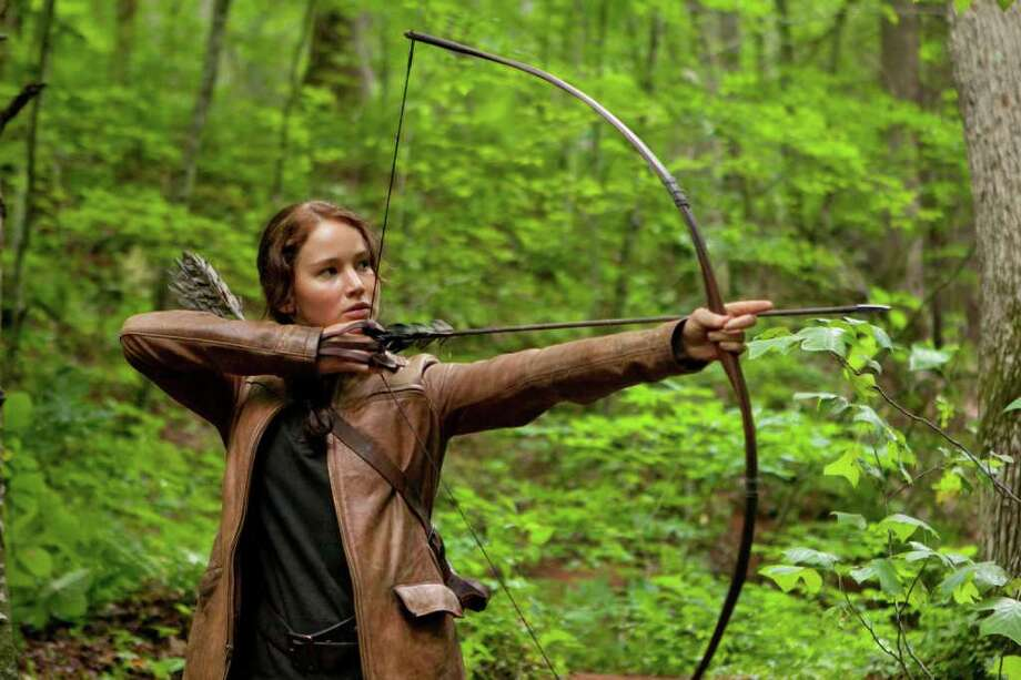 """In this image released by Lionsgate, Jennifer Lawrence portrays Katniss Everdeen in a scene from """"The Hunger Games,"""" opening on Friday, March 23, 2012.  (AP Photo/Lionsgate, Murray Close) Photo: Murray Close"""