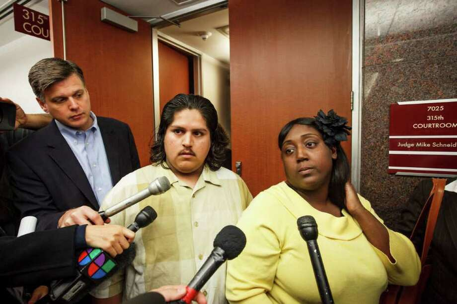 Fernando Morin and Auboni Champion-Morin speak to the media after an emergency court hearing on Wednesday. Photo: Michael Paulsen, Houston Chronicle / © 2012 Houston Chronicle