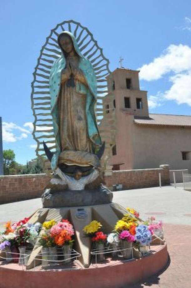 The Santuario de Guadalupe in Santa Fe, N.M., serves as a museum for the archdiocese. Our Lady of Guadalupe, one of the largest and finest oil paints of the Spanish Southwest, dated 1783 and signed by Jose de Alzibar, one of Mexico's most renowned painters. The church also has a 12-foot sculpture of La Virgen. (Melissa Ward Aguilar / Houston Chronicle)
