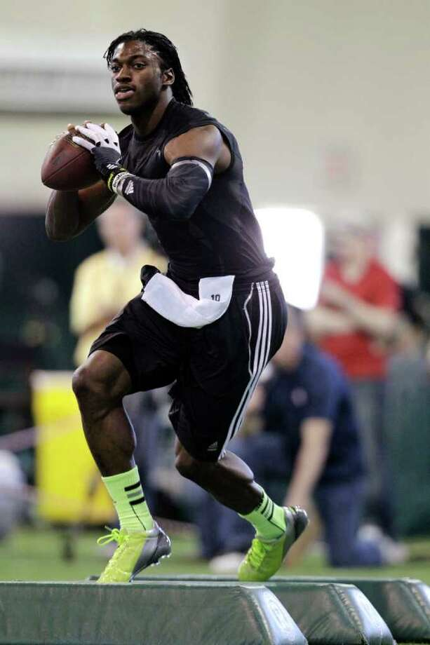 Heisman Trophy winner Robert Griffin III runs a drill during Baylor football pro day Wednesday, March 21, 2012, in Waco, Texas. Photo: AP