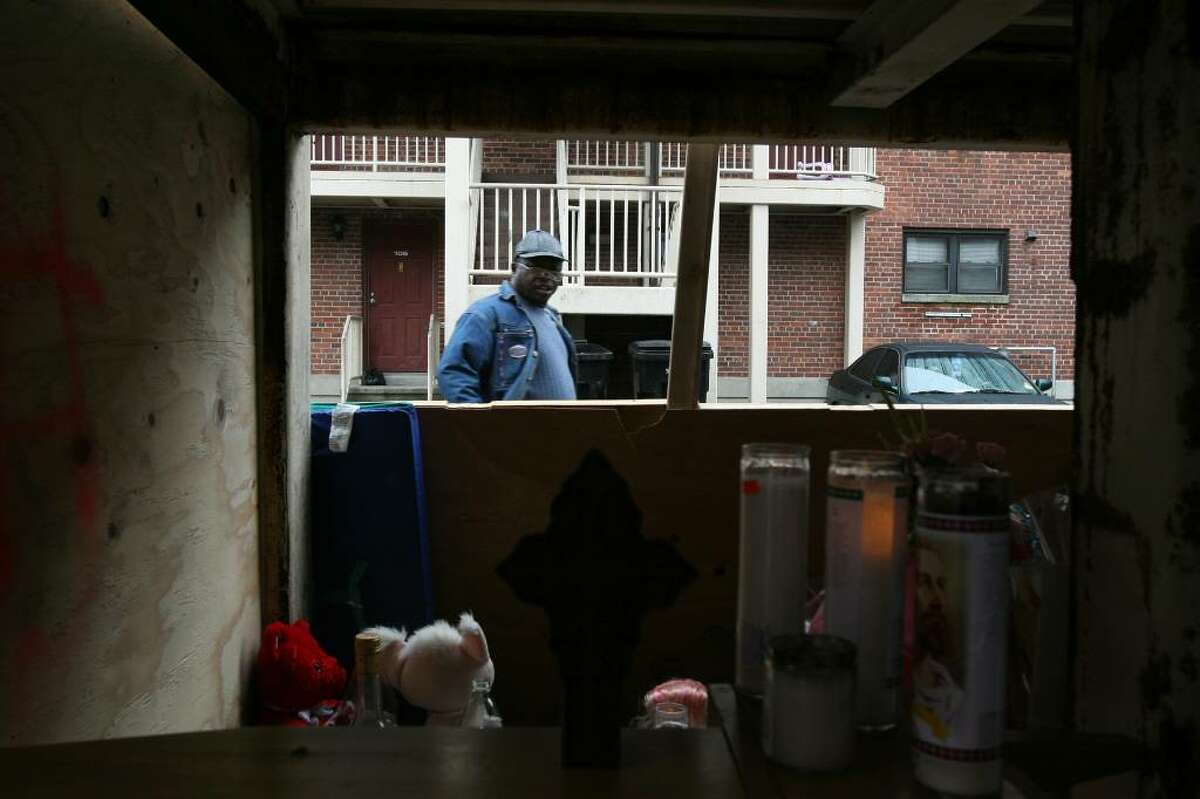 Sidney Hardison visits the memorial on Saturday, Nov. 14, 2009 for his neighbor , Tiana Black, who was killed with her three children in an Nov. 13 early morning fire in the PT Barnum complex in Bridgeport.