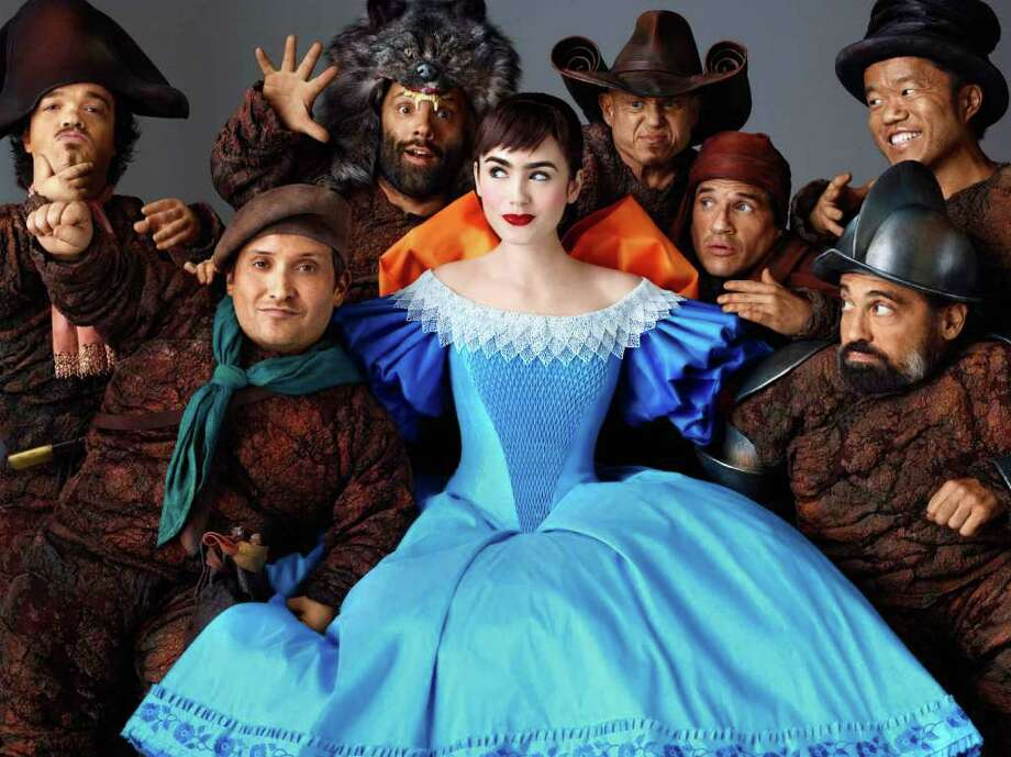 """Lily Collins portrays Snow White in """"Mirror Mirror."""" Julia Roberts, as The Queen, inhabits her role with ease. Photo: Relativity Media / © 2011 Relativity Media, LLC. All Rights Reserved."""