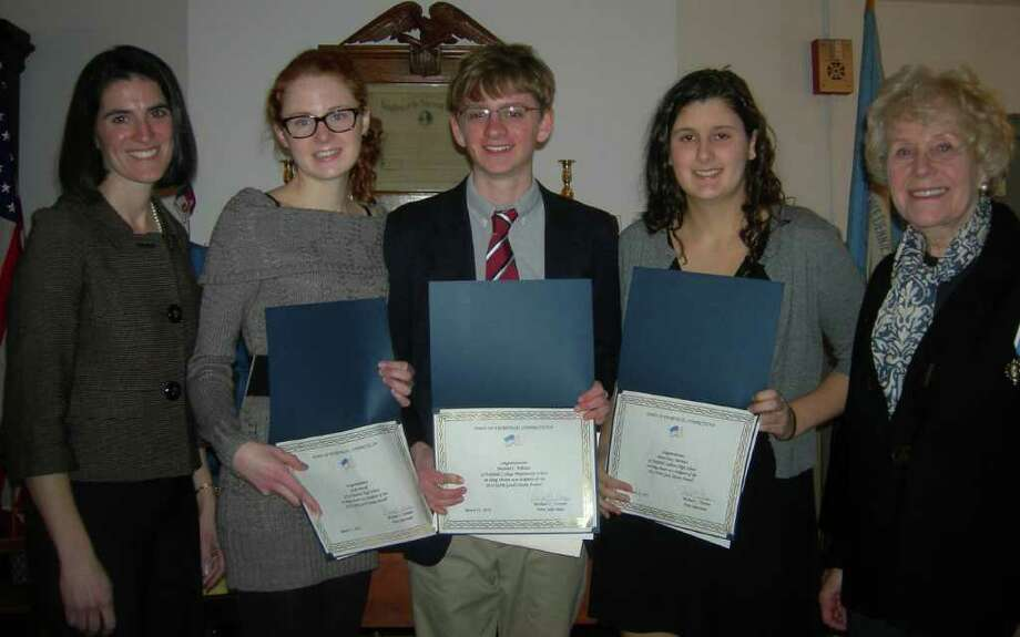 High school students display Good Citizen Certificates awarded by the Daughters of the American Revolution in recognition of the students' community service, academic standing and character. From left are Fairfield Selectman Cristin McCarthy-Vahey, Gayle Powel of Joel Barlow High Schooll, Michael Whelan of Fairfield College Preparatory School, Olivia Morrison of Fairfield Ludlowe High School and Pamela Huth, regent of the Eunice Dennie Burr Chapter of the DAR. One recepient, Mary Teresa Boyle of Notre Dame High School, was absent from the ceremony. Photo: Contributed Photo / Westport News