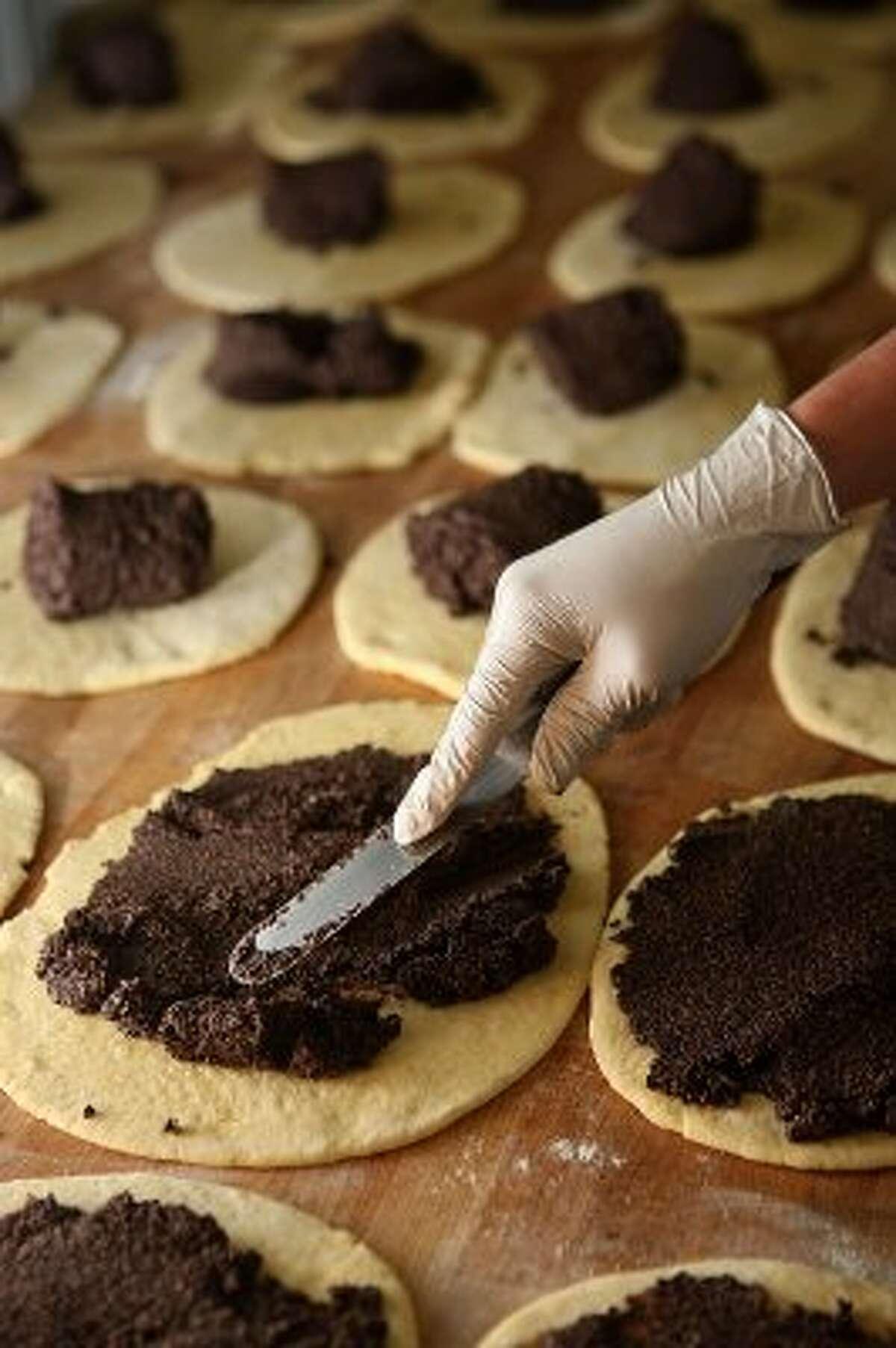 Poppyseed rolls being made (Liz Hafalia / The Chronicle)